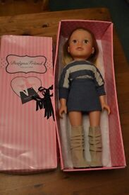 Designer Friend Doll, soft bodied, with 9 sets of clothes