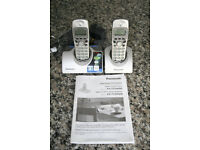 Panasonic landline phones one with answering machine, one a twin set