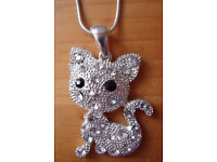 ** NEW ** New Look diamante cat pedant and silver coloured metal chain, with original packaging.
