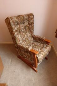 Rocking armchair, excellent condition, high back. Tapestry pattern material.