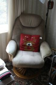 Reclining chair with foot stool.
