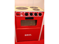 Brio toy oven with Melissa & Doug wooden veg and pots.