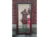 Rosewood upvc window,. 625 wide X 1310 mm
