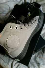 Converse hi tops. Brand new, never worn. Size 4.5.