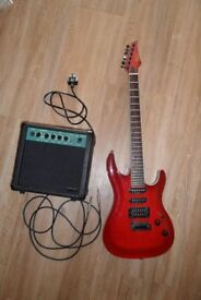 REDWOOD ELECTRIC GUITAR - RED WITH WHITE SURROUND PLUS STAGG 10 GA GUITAR AMPLIFIER WITH LEAD
