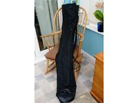 Carp rod carrying bag. Pockets for umbrella, bank sticks etc. Carries 4 rods. Excellent condition