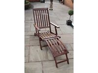 Wooden sun lounger complete with cushion