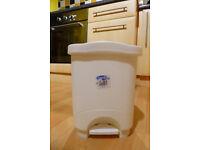 White plastic pedal bin--perfect for bathroom