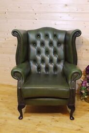 Traditional green leather chesterfield highback, wingback, queen Anne, fireside armchair.