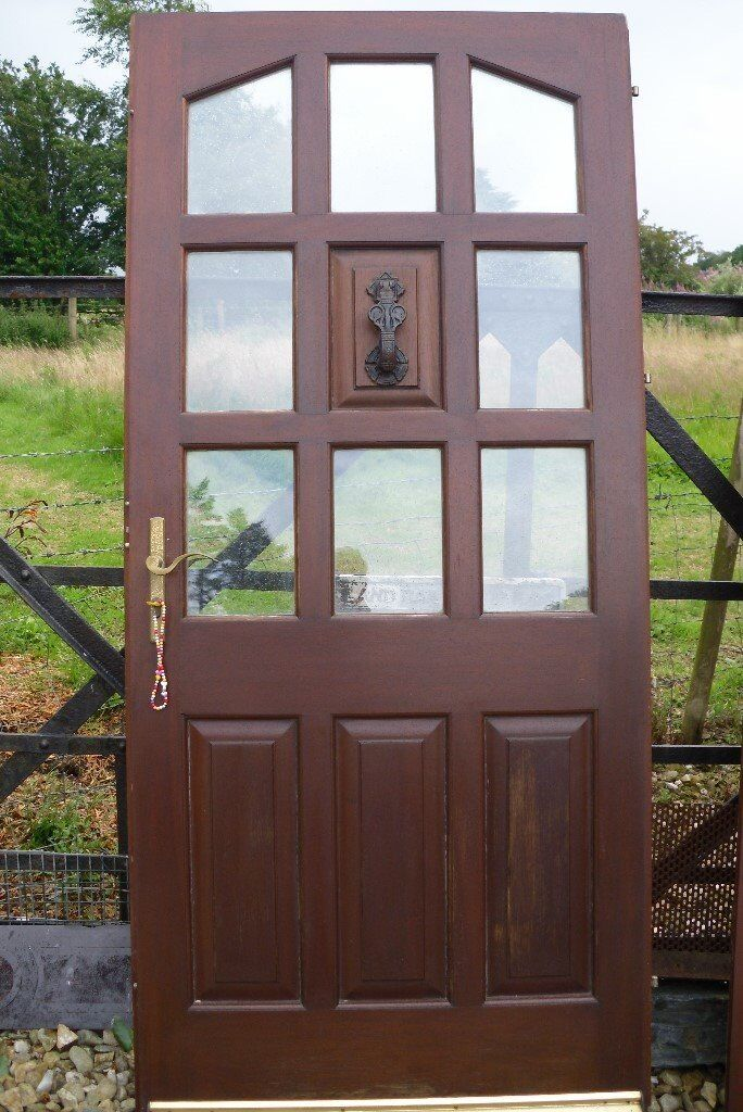 Glass panelled Mahogany door with knocker, heavy door in good condition with working lock and key.