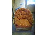 Two wicker cane red/orange patterned comfortable conservatory chairs