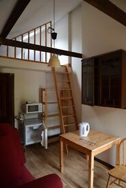 Self-contained studio in attached converted single garage 10 minutes walk south of station