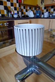 White, striped ceramic flowerpot