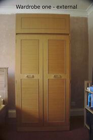 Two teak effect bedroom wardrobes