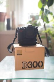 Nikon D300 with spare battery, Batter Grip and 32GB CF Card
