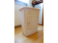 Light, compact but roomy plastic laundry basket-white