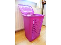 Light, compact, roomy plastic laundry basket-purple