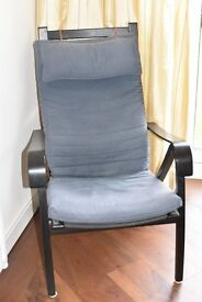 Wooden framed chair with cloth seat