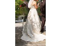A beautiful strapless champagne colour satin wedding dress with train.
