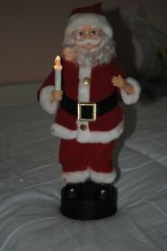 Animated Santa with lit candle a several seasonal tunes.