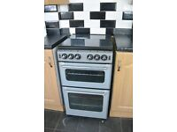 new world gas cooker silver and black