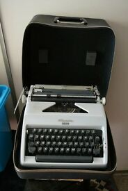 Typewriter, portable, manual, Vintage, Olympia Monica serial no. 3786547, complete with case.