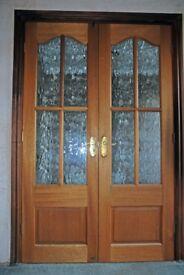 Teak hardwood internal doors complete with handles an hinges.
