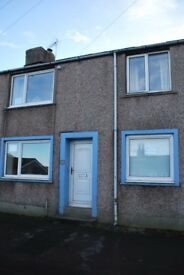 2/3 Bed Terrace in Broughton Moor for Sale yard, garage, garden and block built shed.