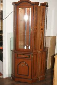 2 corner display cabinets features 2 glass shelves and glass door, small cupboard and internal light