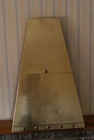 Brass coloured fireplace canopy