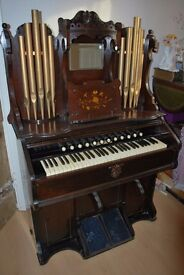 Malcolm and Co Ltd Organ Harmonium with decorative pipes.