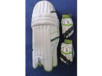 Kookaburra adult cricket pads, gloves & Platylus helmet for right hand batsman