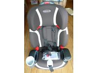 Graco Nautilus childs harnessed booster car seat. Universal 9 kg to 36 kg inc. cup holder & storage