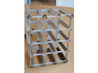 WINE RACK. £4.00. Metal and wood.