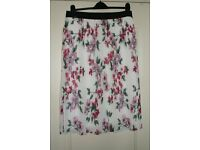 Pleated ladies skirt, very fashionable. Never worn. Size 12