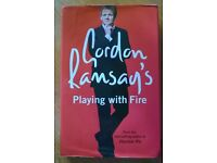 """Gordon Ramsays """"Playing with fire """" hard back book."""