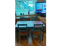 IKEA WOODEN TABLE with FOUR WOODEN IKEA CHAIR'S