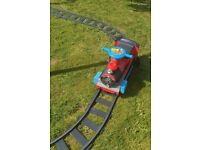 6v ride on train and track