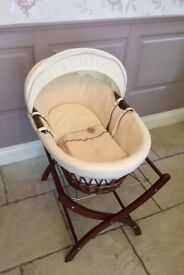 Moses basket and stand by izzy wot not brand. Dark wood and creamWaffle teddy bear design