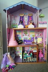 Gorgeous KidKraft three-storey doll's house