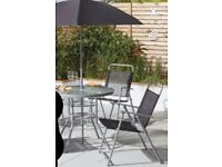 Round glass garden table with 2 folding chairs and a Parasol