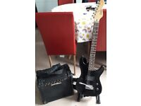 Encore Electric Guitar,stand & Starfire Amp.