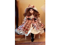 REDUCED-top quality very expensive LARGE 2FT LONG PORCELIN DOLL sitting on her wicker chair