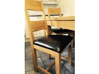 Solid Oak Dining Table With 4 Leather And Chairs