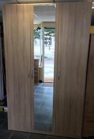 Triple wardrobe with centre mirror hanging rail and shelves