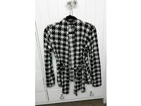 Checked black and white cardigan