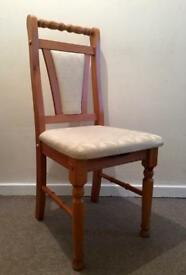 Three cream and pine chairs