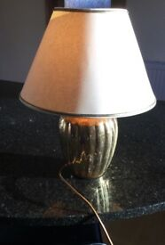 Gold coloured lamp base with matching shade
