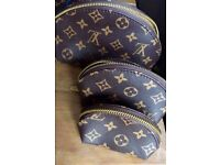 Louis Vuitton cosmetic cases x3