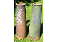A pair of large reclaimed vintage Victorian chimney pots